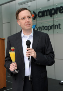 Cimpress COO Don Nelson gives a celebratory toast to team members